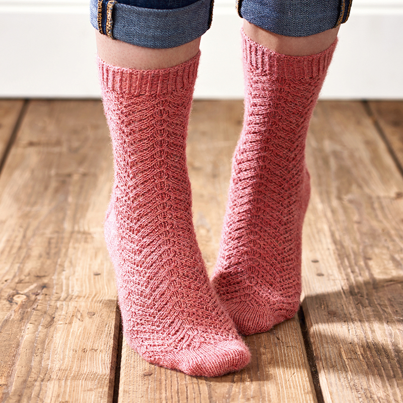 Knitted socks shot on wooden floor